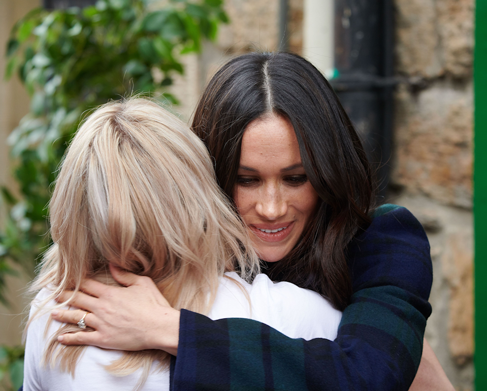 """<p>While visiting Edinburgh (yes, the same trip where she dared to wear the crossbody bag), Meghan <a href=""""https://www.cosmopolitan.com/entertainment/celebs/a17886995/meghan-markle-breaks-royal-protocol-hug/"""" rel=""""nofollow noopener"""" target=""""_blank"""" data-ylk=""""slk:went in for a hug"""" class=""""link rapid-noclick-resp"""">went in for a hug</a> rather than the customary handshake. Kate usually only offers hugs to children, but Meghan's just different like that. </p>"""
