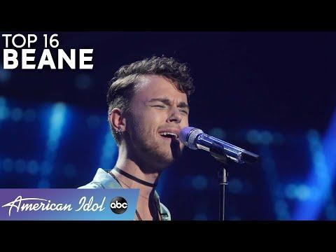 """<p>Beane, or """"modern-day Mister Rogers"""" as Lionel likes to call him, is one of those artists who always brings feel-good energy. But it's not just Beane's warm personality that makes the judges smile. His pure vocals are a force to be reckoned with. After all, Katy couldn't help but give Beane a standing ovation when he took on """"What's Going On!"""" by <strong>Marvin Gaye</strong> in the Showstopper round.</p><p><a href=""""https://www.youtube.com/watch?v=f_0Vm03l3LA"""" rel=""""nofollow noopener"""" target=""""_blank"""" data-ylk=""""slk:See the original post on Youtube"""" class=""""link rapid-noclick-resp"""">See the original post on Youtube</a></p>"""