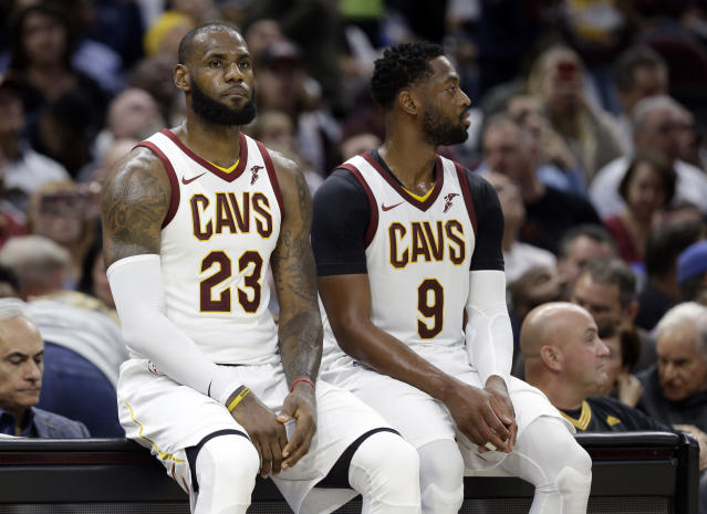 """At least <a class=""""link rapid-noclick-resp"""" href=""""/nba/players/3704/"""" data-ylk=""""slk:LeBron James"""">LeBron James</a> wouldn't let <a class=""""link rapid-noclick-resp"""" href=""""/nba/players/3708/"""" data-ylk=""""slk:Dwyane Wade"""">Dwyane Wade</a> sit at the scorer's table alone. (AP)"""