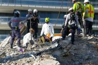 Search and rescue personnel work at the site of a collapsed Florida condominium complex in Surfside, Miami, U.S. in this picture obtained from social media