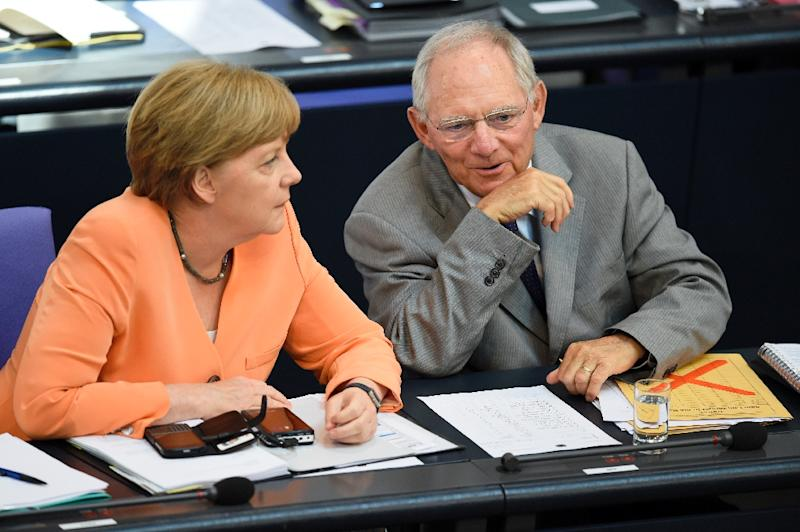 "German Finance Minister Wolfgang Schaeuble (R) and German Chancellor Angela Merkel attend a session at the Bundestag lower house of parliament on the Greek crisis on July 1, 2015 in Berlin. German Chancellor Angela Merkel said that ""the future of Europe is not at stake"" because of the crisis over Greece after the breakdown of debt talks and expiry of its aid programme. AFP PHOTO / ODD ANDERSEN (AFP Photo/Odd Andersen)"