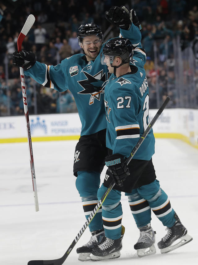 San Jose Sharks right wing Joonas Donskoi (27), from Finland, is congratulated by Tomas Hertl, from the Czech Republic, after scoring against the Edmonton Oilers during the first period of an NHL hockey game in San Jose, Calif., Tuesday, Jan. 8, 2019. (AP Photo/Jeff Chiu)