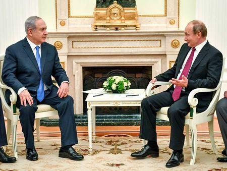Russian President Putin speaks with Israeli PM Netanyahu during their meeting at the Kremlin in Moscow