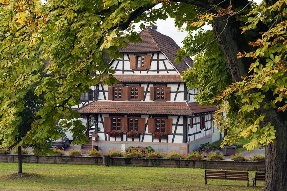 """<p><strong>Population:</strong> 653</p> <p>We're big fans of Hunspach in Alsace—as are the French. In 2020, the tiny town near the German border was voted <a href=""""https://www.lonelyplanet.com/articles/hunspach-voted-best-french-village"""" rel=""""nofollow noopener"""" target=""""_blank"""" data-ylk=""""slk:the country's favorite"""" class=""""link rapid-noclick-resp"""">the country's favorite</a> village in <em>Village préféré des Français</em>, a TV program that polls citizens every year to crown a winner. Hunspach continues to win over citizens and foreigners alike with its friendly locals, walkable streets, and famous half-timbered houses lined with flower boxes.</p>"""