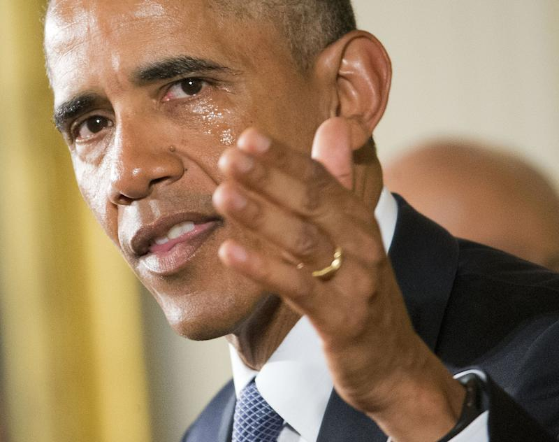 His cheek wet with tears, President Barack Obama President Barack Obama recalls the 20 first-graders killed in 2012 at Sandy Hook Elementary School, while speaking in the East Room of the White House in Washington, Tuesday, Jan. 5, 2016, about steps his administration is taking to reduce gun violence. (Photo: Pablo Martinez Monsivais/AP)