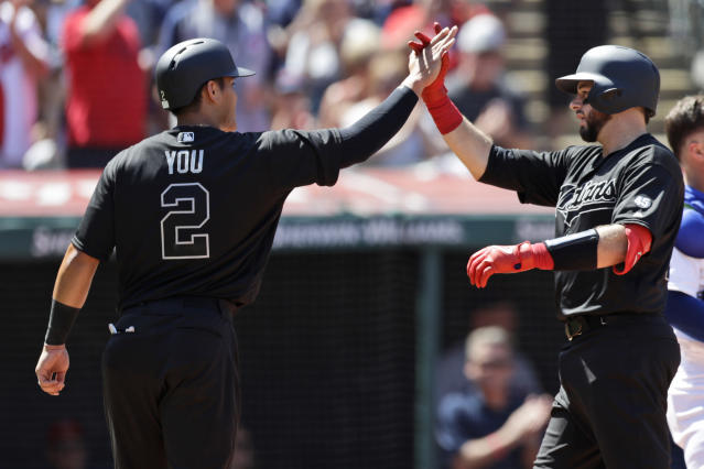 Cleveland Indians' Kevin Plawecki, right, and Yu Chang celebrate after Plawecki hit a two-run home run in the third inning of a baseball game, Sunday, Aug. 25, 2019, in Cleveland. Chang scored on the play. (AP Photo/Tony Dejak)