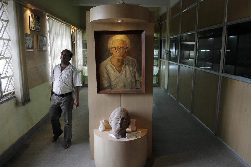 """A portrait of Indian scientist Satyendranath Bose, is displayed at the Bangiya Vigyan Parishad or the Bengal Science Society founded by Bose in Kolkata, India, Tuesday, July 10, 2012. While much of the world was celebrating the international cooperation that led to last week's breakthrough in identifying the existence of the Higgs boson particle, many in India were smarting over what they saw as a slight against one of their greatest scientists. Media covering the story gave lots of credit to British physicist Peter Higgs for theorizing the elusive subatomic """"God particle,"""" but little was said about Satyendranath Bose, the Indian after whom the boson is named. (AP Photo/Bikas Das)"""
