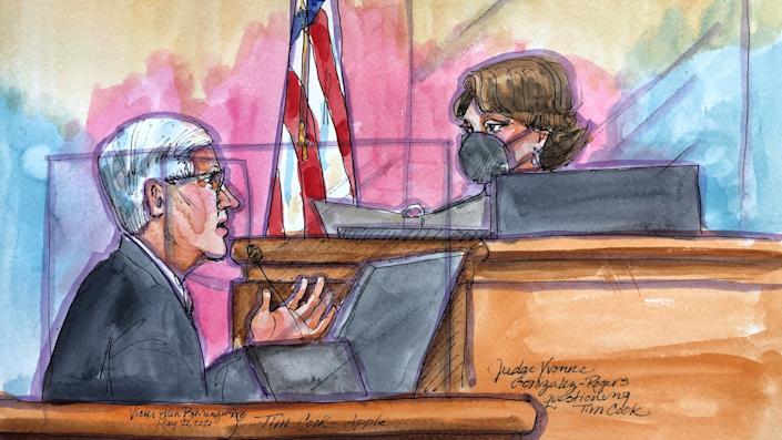 Apple CEO Tim Cook is questioned by Judge Yvonne Gonzalez Rogers as he testifies on the stand during a weeks-long antitrust trial at federal court in Oakland, California, U.S. May 21, 2021 in this courtroom sketch. Cook on Friday told a court that threats to iPhone security and privacy required tight control of the App Store, which