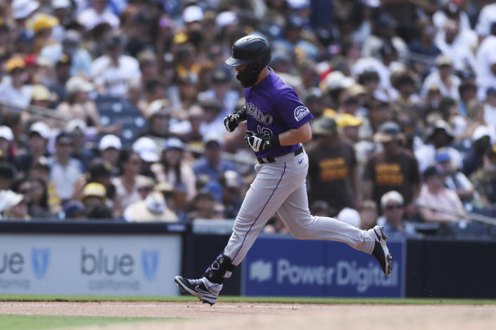 Colorado Rockies' Chris Owings rounds third base after hitting a solo home run off San Diego Padres relief pitcher Craig Stammen in the seventh inning of a baseball game Sunday, July 11, 2021, in San Diego. (AP Photo/Derrick Tuskan)