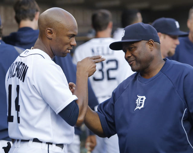 In this Aug. 17, 2013, photo, Detroit Tigers center fielder Austin Jackson talks with hitting coach Lloyd McClendon during a baseball game against the Kansas City Royals in Detroit. The Seattle Mariners have hired McClendon to be their next manager. The Mariners announced their decision on Tuesday, Nov. 5. McClendon becomes the third manager hired by general manager Jack Zduriencik. McClendon will be formally introduced by the team later this week. (AP Photo/Duane Burleson)