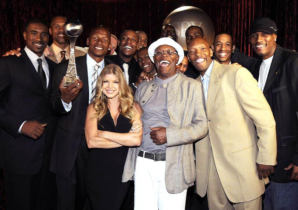 """Even though Fergie cheered for her hometown Lakers during the NBA Finals, she was a good sport and posed with the Boston Celtics - and Samuel L. Jackson - backstage. Kevin Mazur//<a href=""""http://www.wireimage.com"""" target=""""new"""">WireImage.com</a> - July 16, 2008"""