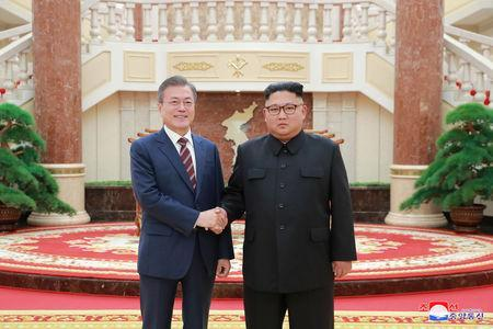 South Korean President Moon Jae-in shakes hands with North Korean leader Kim Jong Un as they arrive for their meeting at the headquarters of the Central Committee of the Workers' Party of Korea in Pyongyang, North Korea in this photo released by North Korea's Korean Central News Agency (KCNA) September 19, 2018. KCNA/via REUTERS
