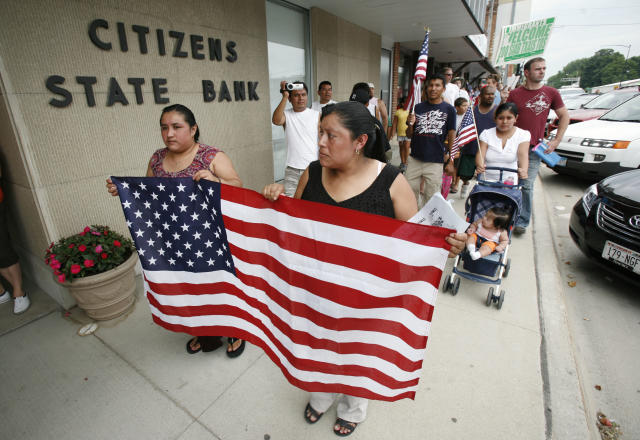 An immigration rally in Postville, Iowa. (Photo: Charlie Neibergall/AP)