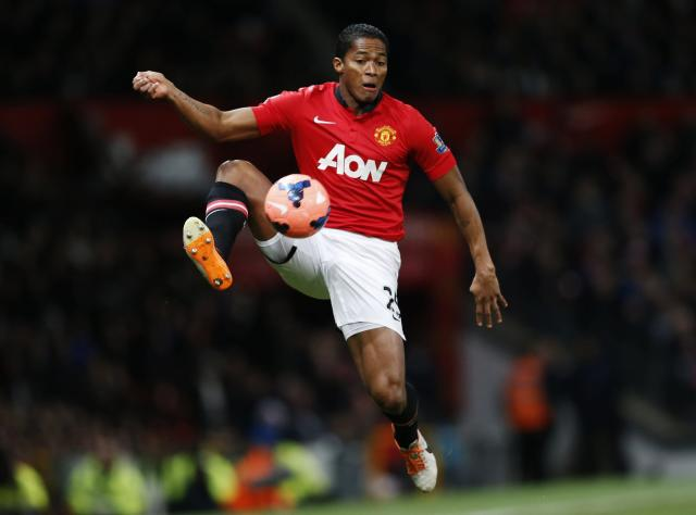 Manchester United's Antonio Valencia controls the ball during their English FA Cup third round soccer match against Swansea City at Old Trafford in Manchester, northern England January 5, 2014. REUTERS/Russell Cheyne (BRITAIN - Tags: SPORT SOCCER)