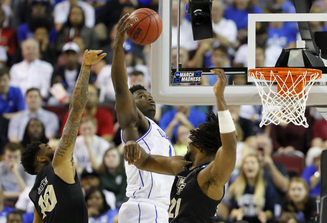 <p>Zion Williamson #1 of the Duke Blue Devils shoots the ball against the UCF Knights during the first half in the second round game of the 2019 NCAA Men's Basketball Tournament at Colonial Life Arena on March 24, 2019 in Columbia, South Carolina. (Photo by Kevin C. Cox/Getty Images) </p>