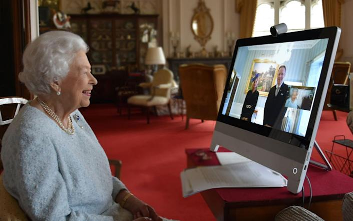 In a handout picture released by Buckingham Palace on December 4, 2020, Britain's Queen Elizabeth II, at Windsor Castle, west of London, speaks to His Excellency Dr. Ferenc Kumin, Ambassador of Hungary - Buckingham Palace/AFP