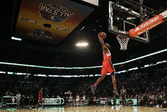 John Wall of the Washington Capitals participates in the slam dunk contest during the skills competition at the NBA All Star basketball game, Saturday, Feb. 15, 2014, in New Orleans. (AP Photo/Gerald Herbert)