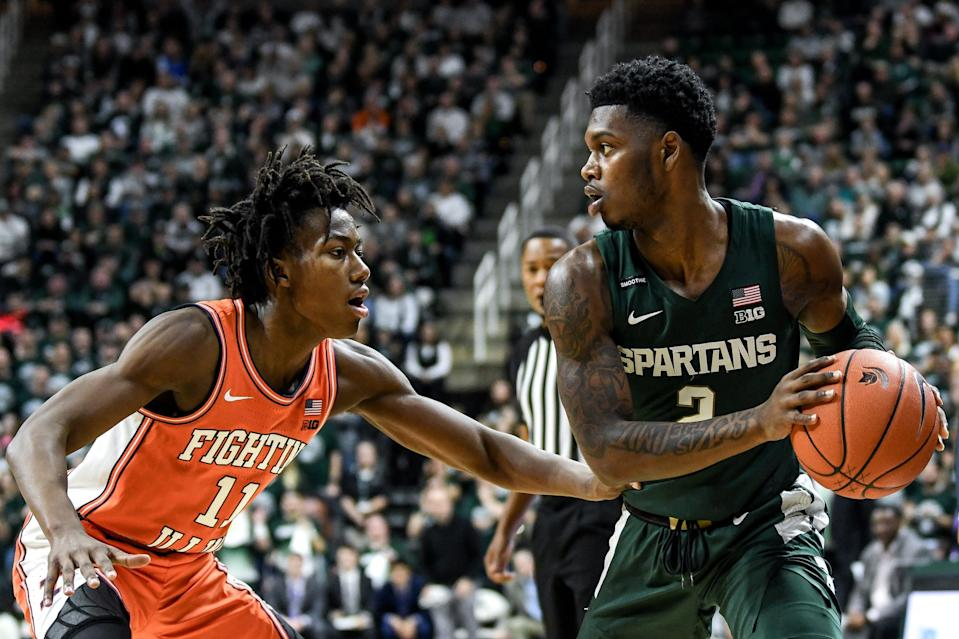 Michigan State's Rocket Watts, right, looks to pass as Illinois' Ayo Dosunmu defends during the first half on Thursday, Jan. 2, 2020, at the Breslin Center in East Lansing.