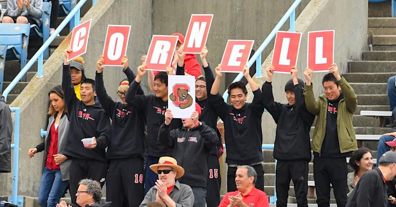 Cornell Big Red fans hold up signs to spell out CORNELL against the Yale Bulldogs during the 2018 Ivy League Men's Lacrosse Championship at Lawrence A. Wien Stadium on May 6, 2018 in New York City.