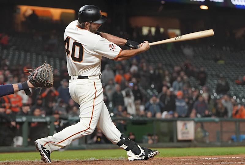 SAN FRANCISCO, CA - SEPTEMBER 25: Madison Bumgarner #40 of the San Francisco Giants hits an rbi walk-off single scoring Gorkys Hernandez #7 to defeat the San Diego Padres 5-4 in 12 inning at AT&T Park on September 25, 2018 in San Francisco, California. (Photo by Thearon W. Henderson/Getty Images)
