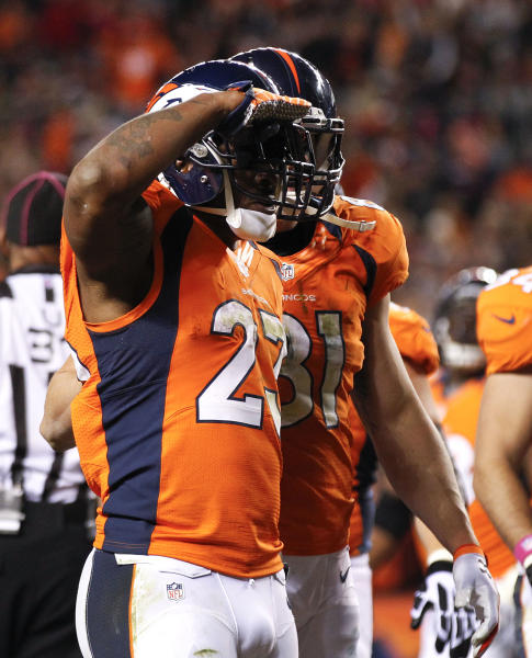 Denver Broncos running back Willis McGahee (23) reacts after scoring a touchdown against the New Orleans Saints in the first quarter of an NFL football game, Sunday, Oct. 28, 2012, in Denver. (AP Photo/David Zalubowski)