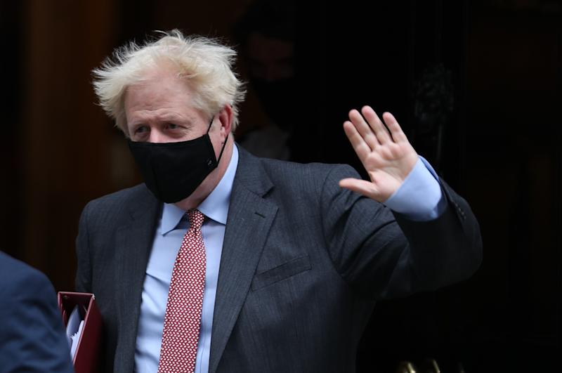 Prime Minister Boris Johnson leaves 10 Downing Street to attend Prime Minister's Questions, at the Houses of Parliament, London. (Photo by Yui Mok/PA Images via Getty Images)