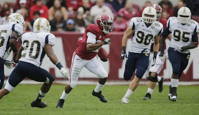 Alabama wide receiver Christion Jones (22) outruns Chattanooga linebacker Wes Dothard, left, defensive back D.J. Key (20), defensive lineman Davis Tull (90) and defensive lineman Josh Freeman (95) on a punt return during the first half of an NCAA college football game in Tuscaloosa, Ala., Saturday, Nov. 23, 2013. (AP Photo/Dave Martin)