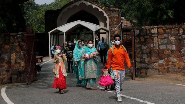 PHOTO: A family visits the Qutab Minar monument after monuments across India were reopened after almost four moths of lockdown to control the spread of coronavirus, in New Delhi, India, July 6, 2020. (Manish Swarup/AP)