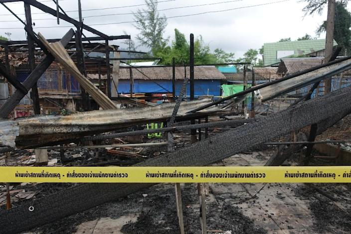 Police tape cordons off burned buildings at the site of a bomb blast and arson attack on Bang Niang market, Takua Pa, near Khao Lak, Thailand on August 12, 2016 (AFP Photo/Jerome Taylor)