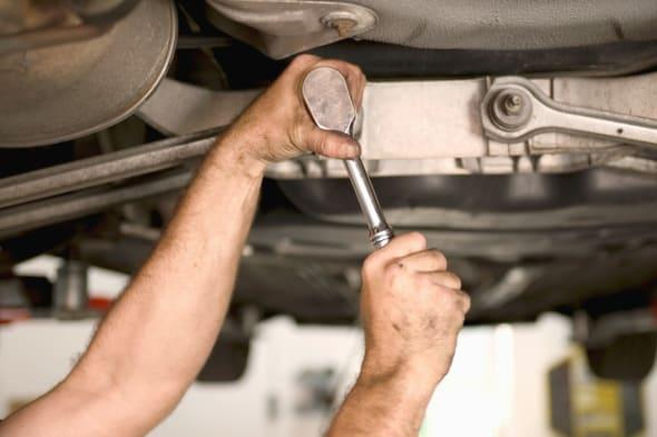 Title:   Mechanic working on car undercarriage, close-up Creative image #:  200157278-001 License type:  Royalty-free Photograph