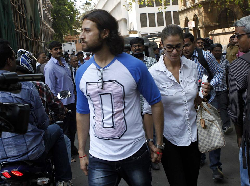 MUMBAI, INDIA - MARCH 25: Actor Apoorva Agnihotri and his wife Shilpa comes out of a Sessions court after police filed a charge sheet in a rave party case on March 25, 2013 in Mumbai, India. 44 people were tested positive for the drugs including actor Apoorva Agnihotri and cricketer Rahul Sharma after the Mumbai police had raided the alleged rave party the hotel in suburban Juhu on May 20 last year.(Hindustan Times/Kunal Patil)