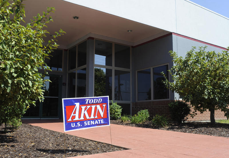 "A campaign sign stands outside the Senate campaign office of U.S. Rep. Todd Akin, R-Mo., Tuesday, Aug. 21, 2012 in Chesterfield, Mo. Rep. Akin has come under pressure to abandon his Senate compaign after his comments that women's bodies can prevent pregnancies in cases of ""legitimate rape"". (AP Photo/Bill Boyce)"