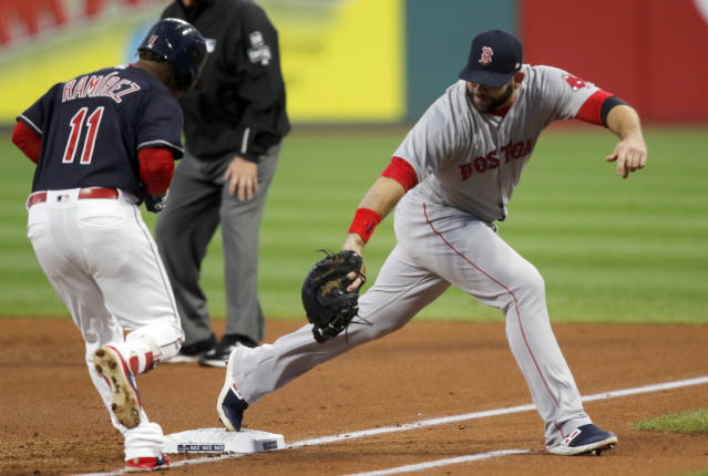 Boston Red Sox first baseman Mitch Moreland, right, stretches to get Cleveland Indians' Jose Ramirez out in the first inning of a baseball game, Sunday, Sept. 23, 2018, in Cleveland. (AP Photo/Tom E. Puskar)