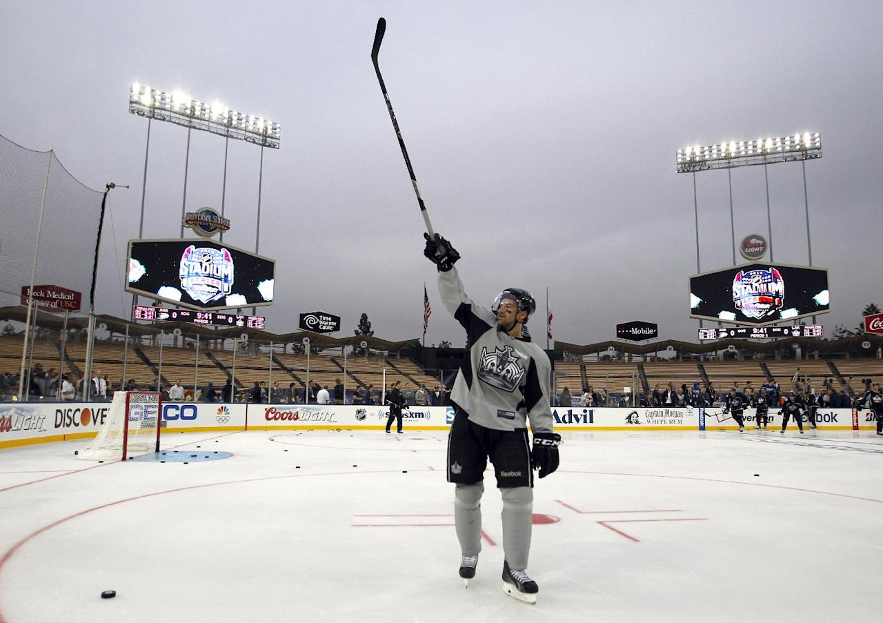 Los Angeles Kings right wing Justin Williams calls for his family to participate during family skate time after practice for the NHL Stadium Series hockey game Friday, Jan. 24, 2014, in Los Angeles. The Los Angeles Kings and the Anaheim Ducks will play outdoors at Dodger Stadium on Saturday. (AP Photo/Alex Gallardo)