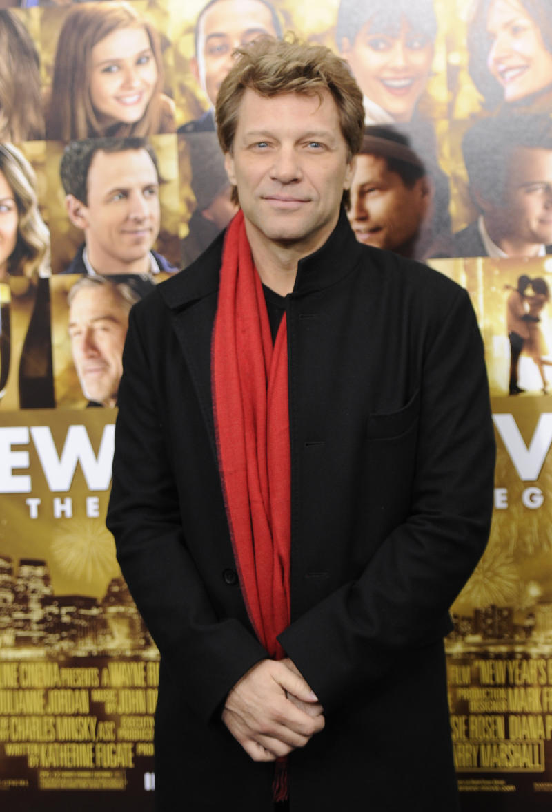 "FILE - This Dec. 7, 2011 file photo shows singer Jon Bon Jovi attending the premiere of ""New Year's Eve"" at Ziegfeld Theatre in New York. A New Jersey man will face five years in prison after pleading guilty to a string of burglaries at the Jersey shore, including the home of rocker Jon Bon Jovi. Nicholas Tracy of Beachwood pleaded guilty Tuesday to three counts of theft and burglary from a spree that netted him more than $300,000 worth of jewelry and personal items from the homes. The thefts took place in March and April 2011 along the Middletown Township road where Bon Jovi lives. (AP Photo/Evan Agostini, file)"