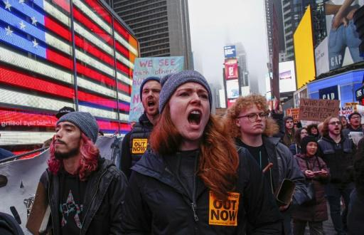 Demonstrators opposed to the US military presence in Iraq march in New York