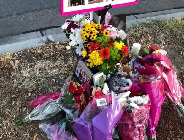 On Nov. 4, 2020, people gathered at a roadside memorial for a young woman who died after being struck while crossing Albert Street.