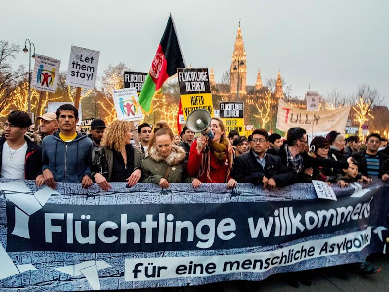 Austrian citizens and asylum seekers march during a pro-refugee protest called 'Let them stay' in Vienna, Austria on November 26, 2016. (AFP/Getty Images)
