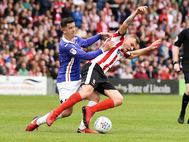"Soccer Football - League Two Play Off Semi Final First Leg - Lincoln City v Exeter City - Sincil Bank, Lincoln, Britain - May 12, 2018 Lincoln City's Harry Anderson in action with Exeter City's Lloyd James Action Images/Paul Burrows EDITORIAL USE ONLY. No use with unauthorized audio, video, data, fixture lists, club/league logos or ""live"" services. Online in-match use limited to 75 images, no video emulation. No use in betting, games or single club/league/player publications. Please contact your account representative for further details."