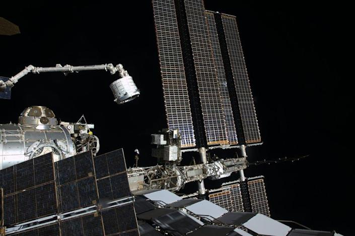 The Bigelow Expandable Activity Module, an inflatable space room built by Bigelow Aerospace, is moved by robotic arm to its new home on the International Space Station on April 16, 2016 in this exterior camera view. BEAM