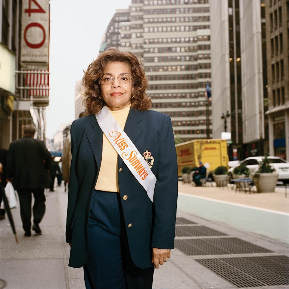 "This 2009 photo provided by Fiona Gardner shows Marcia Kilpatrick Hocker on a Midtown Manhattan street in New York. Hocker appeared on placards in the New York City subways during Nov. 1974–April 1975 in the ""Meet Miss Subways"" campaign that ran for 35 years as eye candy to bring attention to other advertisements in New York's transit system. ""Meet Miss Subways: New York's Beauty Queens 1941-76,"" is now an exhibition at the New York Transit Museum running Oct. 23-March 25, and a companion book of the same name with current-day photos of the women by photographer Fiona Gardner. (AP Photo/Fiona Gardner)"