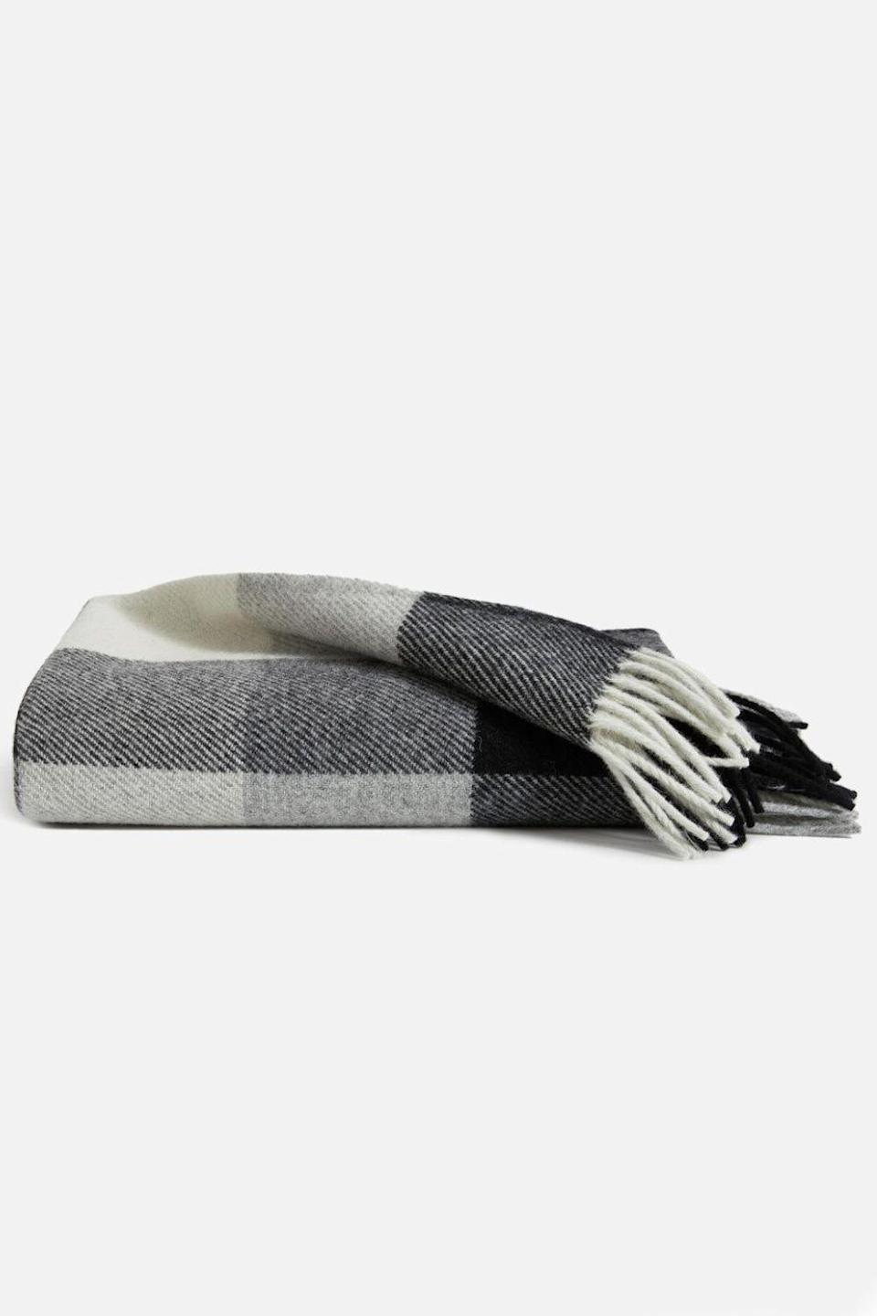 """<p><strong>Pendelton</strong></p><p>brooklinen.com</p><p><strong>$109.00</strong></p><p><a href=""""https://go.redirectingat.com?id=74968X1596630&url=https%3A%2F%2Fwww.brooklinen.com%2Fproducts%2Fpendleton-throw-blanket&sref=https%3A%2F%2Fwww.cosmopolitan.com%2Fstyle-beauty%2Ffashion%2Fg32619153%2Fgifts-for-man-who-has-everything%2F"""" rel=""""nofollow noopener"""" target=""""_blank"""" data-ylk=""""slk:Shop Now"""" class=""""link rapid-noclick-resp"""">Shop Now</a></p><p>Get him this blanket made from eco-wise wool—even if you'll most likely be the one using it all the time.</p>"""