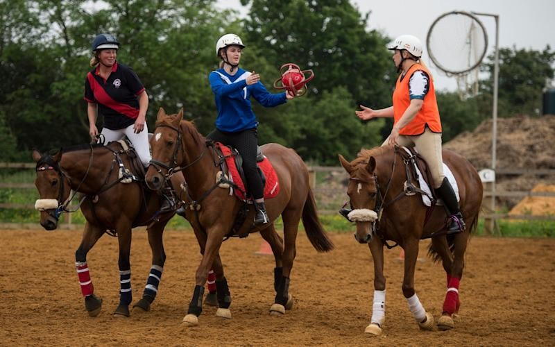 Cristina Criddle (centre) tries her hand at horseball - Stella Pictures Limited