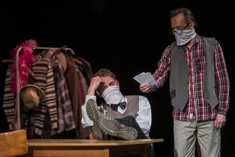 Actors wearing protective masks perform inside a theater during the first live theater show in the country as the Czech government lifted more restrictions allowing public events up to 100 people if it's possible to keep social distancing on May 12, 2020, in Jablonec nad Nisou, Czech Republic. The Czech government has begun further easing the restrictive measures to slow down the spread of the pandemic coronavirus disease. (Photo by Gabriel Kuchta/Getty Images)