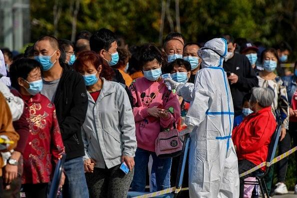 China has largely been successful in bringing infection rates down with mass testing and strict city-wide lockdowns (AFP via Getty Images)