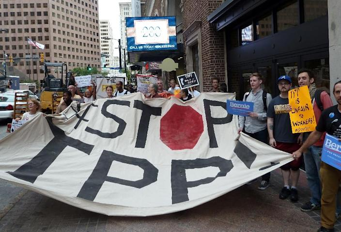 """Forty-five of the 50 private corporations historically responsible for the most climate-disrupting emissions would be empowered to challenge climate policies"" if the TPP and TTIP are implemented, the Sierra Club said (AFP Photo/Paul Handley)"