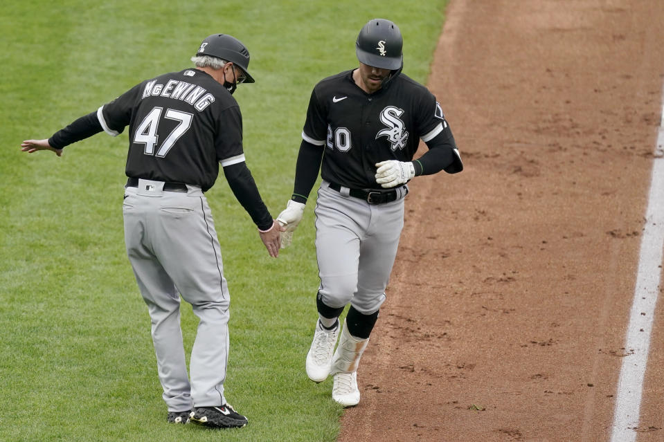 Chicago White Sox's Danny Mendick (20) celebrates with third base coach Joe McEwing (47) after hitting a two-run home run during the first inning of a baseball game against the Kansas City Royals Saturday, May 8, 2021, in Kansas City, Mo. (AP Photo/Charlie Riedel)
