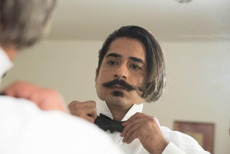 Haghjoo adjusts his bow tie before the wedding ceremony. (Courtesy of Ramin Haghjoo)