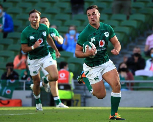 Ireland's Ronan Kelleher carries the ball for a try