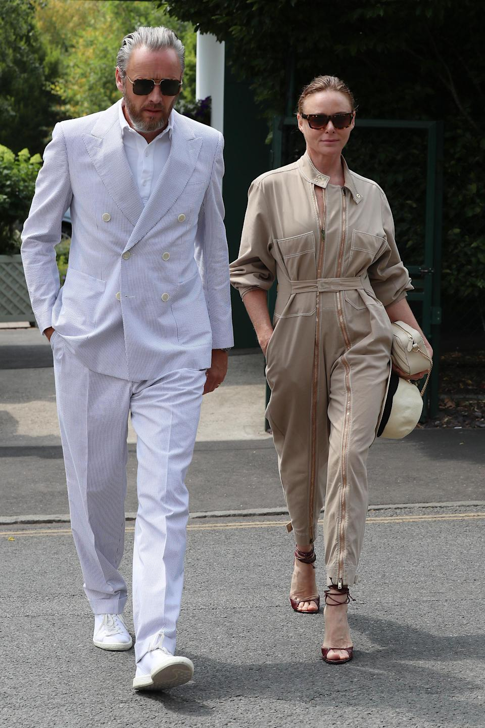 <p>On day seven, Stella McCartney and her husband, Alasdhair Willis, joined the A-list guest list at Wimbledon. <em>[Photo: Getty]</em> </p>